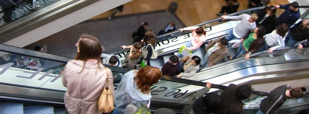 people out shopping on escalator